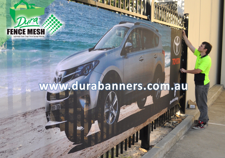 Picture of a Toyota Car On A FENCE WRAP