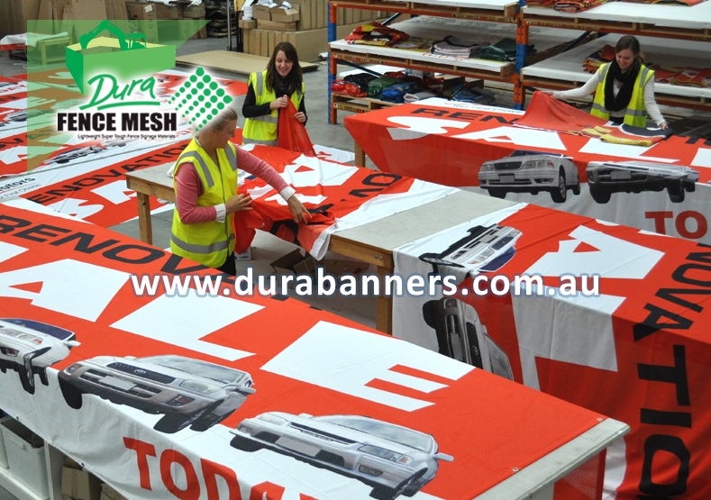 The flag factory in full swing making factory direct to you flags signs and banners